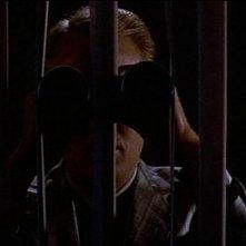 Gregg Henry in una scena di OMICIDIO A LUCI ROSSE