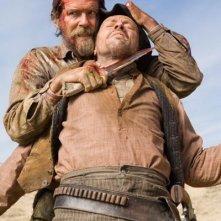 Pierce Brosnan in una immagine del western Caccia spietata