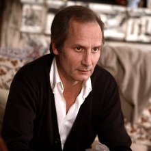 Hippolyte Girardot in una sequenza del film Un conte de Noël