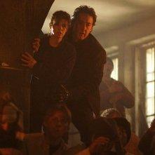 Marisa Tomei e John Cusack in una scena del film War, Inc.