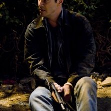 Keanu Reeves in una scena del film La notte non aspetta