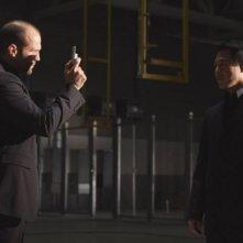 Jason Statham con Jet Li in una scena di Rogue - Il solitario