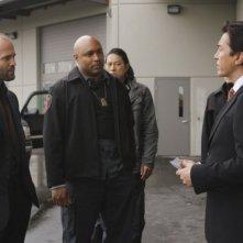 Jason Statham, Mathew St. Patrick, Sung Kang e John Lone in una scena del film Rogue - Il solitario