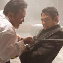 Ryo Ishibashi e Jet Li in una scena di Rogue - Il solitario