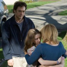 John Cusack e Shélan O'Keefe in una scena del film Grace is Gone