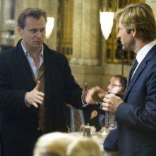 Il regista Christopher Nolan e Aaron Eckhart sul set del film Il cavaliere oscuro