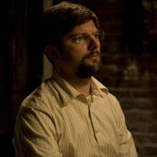 Adam Scott in una scena del film August