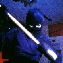 L'assassino dal volto nascosto in una sequenza del film Non entrate in quella casa