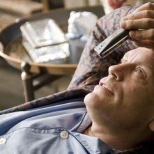 John Malkovich in una scena del film Burn After Reading dei fratelli Coen