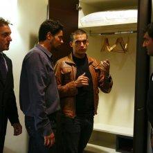 Simone Corrente, Enrico Silvestrin e Max Giusti in una scena di Distretto di Polizia 8