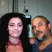 Eleonora Stagi accanto al maestro Sergio Stivaletti sul set del film IN THE MARKET