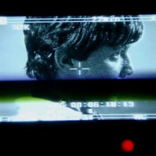 Marco Martini durante una scena del film IN THE MARKET visto attraverso il view-finder della camera