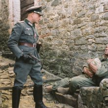 Christian Berkel e Laz Alonso in una scena del film Miracolo a Sant'Anna
