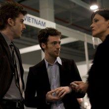 Michele Riondino, Elio Germano e Chiara Caselli in un'immagine del film Il passato è una terra straniera