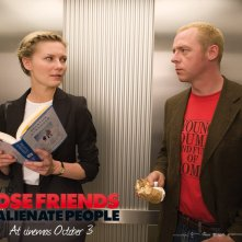 Un wallpaper del film How to Lose Friends and Alienate People con Kirsten Dunst e Simon Pegg