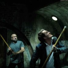 Carlo Rota e Greg Bryk in una scena del film Saw V