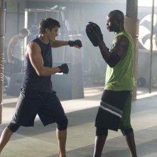 Sean Faris e Djimon Hounsou in una scena del film Never Back Down
