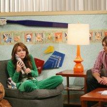 Miley Cyrus e Billy Ray Cyrus in una scena dell'episodio Don't Go Breaking My Tooth di Hannah Montana