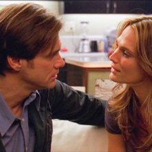 Jim Carrey e Molly Sims in una scena del film Yes Man