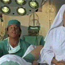Liliana Dell'Aquila con Christian De Sica in una scena del film Tifosi, di Neri Parenti