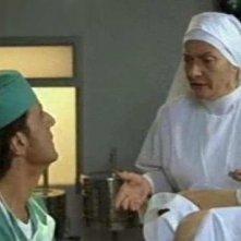 Liliana Dell'Aquila e Christian De Sica in una scena del film Tifosi, di Neri Parenti