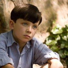 Un'intensa immagine di Asa Butterfield ne Il bambino con il pigiama a righe