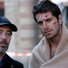 Paolo Sassanelli e Giampaolo Morelli in una scena della seconda stagione della serie tv L'ispettore Coliandro