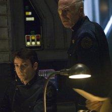Michael Hogan e Brad Dryborough in una scena di The Oath da Battlestar Galactica