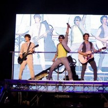 Nick, Joe e Kevin Jonas in un momento del film-concerto Jonas Brothers: The 3D Concert Experience