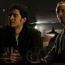 Claudio Santamaria e Iain Glen in una scena del film Il caso dell'infedele Klara