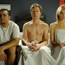 Ennis Esmer, Peter Oldring e Natalie Lisinska in una scena del film Young People Fucking