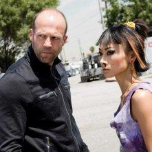 Jason Statham e Bai Ling in una scena del film Crank 2: High Voltage