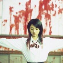 Una disturbante immagine del film Love Exposure (Ai no mukidashi)
