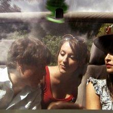 Dal film IN THE MARKET: David, Nicole e Sarah nella jeep (Marco Martini, Elisa Sensi e Rossella Caiani)