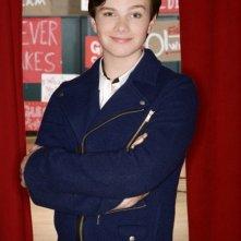 Chris Colfer in una foto promozionale della serie Glee