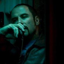 John Travolta in una scena del film Pelham 1-2-3: Un ostaggio al minuto