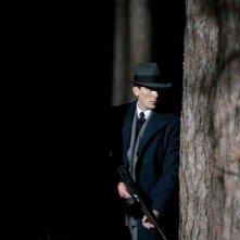 Christian Bale in un'immagine del film Nemico pubblico
