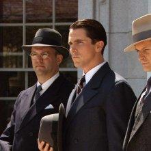 Christian Bale in una sequenza di Nemico pubblico