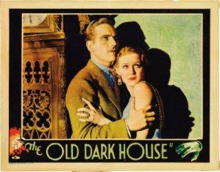 Raymond Massey e Gloria Stuart in una lobbycard a colori del film Il castello maledetto