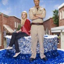 Colin Ferguson e Jordan Hinson in una foto promozionale della stagione 3 della serie televisiva Eureka