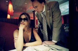 Eva Mendes e Nicolas Cage in una scena del film Bad Lieutenant: Port of Call New Orleans