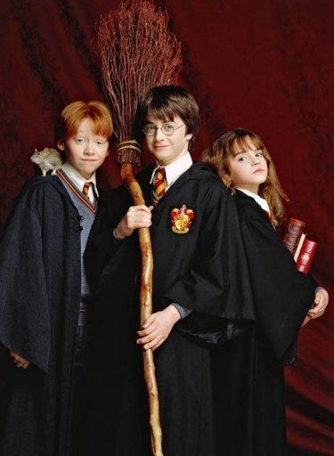 Rupert Grint, Daniel Radcliffe, Emma Watson e il topo Crosta per il film Harry Potter e la pietra filosofale