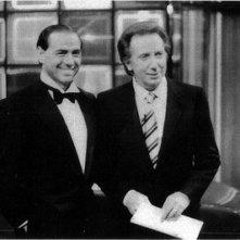 Mike Bongiorno accanto a Silvio Berlusconi, agli inizi degli anni '80.