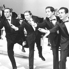 Quattro icone della tv italiana: Mike Bongiorno, Corrado, Pippo Baudo ed Enzo Tortora.