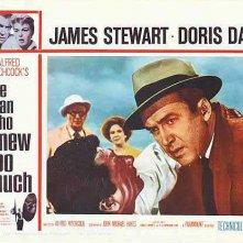 James Stewart e Daniel Gélin in una lobbycard promozionale del film L\'uomo che sapeva troppo