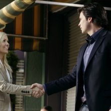 Tom Welling con Emilie Ullerup in una scena dell'episodio Crossfire di Smallville