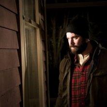 AJ Bowen in una scena del film horror The House of the Devil