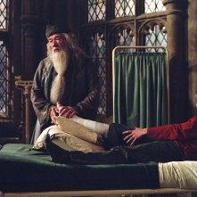 Il preside di Hogwarts, Albus Silente (Michael Gambon) e Ron Weasley (Rupert Grint)