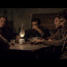 Claudio Casadio in una scena di gruppo nel film L'uomo che verrà