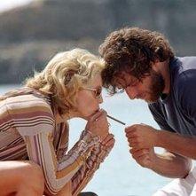 Madonna con Adriano Giannini in una scena di Travolti dal destino
